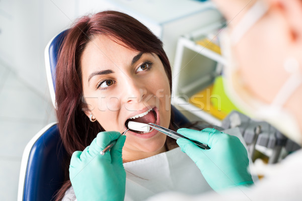 Preparing patient for a dental treatment Stock photo © MilanMarkovic78