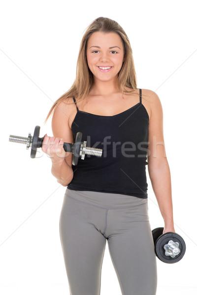 Bíceps ejercicio cute deportivo pesas Foto stock © MilanMarkovic78