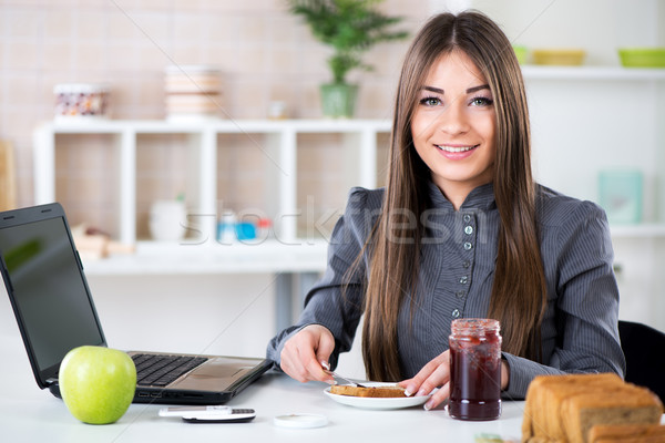 Businesswoman making breakfast Stock photo © MilanMarkovic78