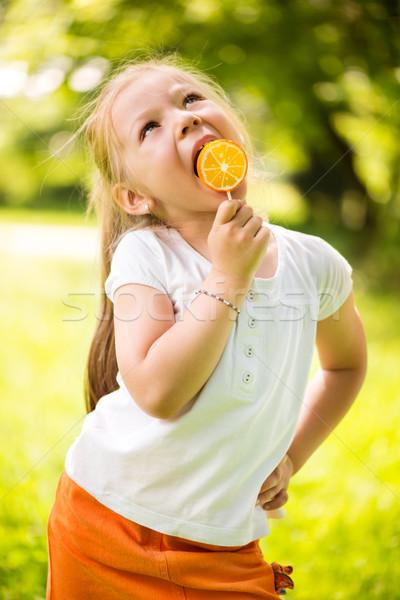 Little Girl With Lollipop Stock photo © MilanMarkovic78