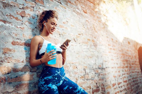 Girl Listening Music After Running Stock photo © MilanMarkovic78