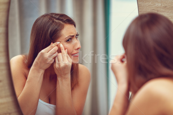 Stock photo: Little Pimple, You Don't Belong Here!