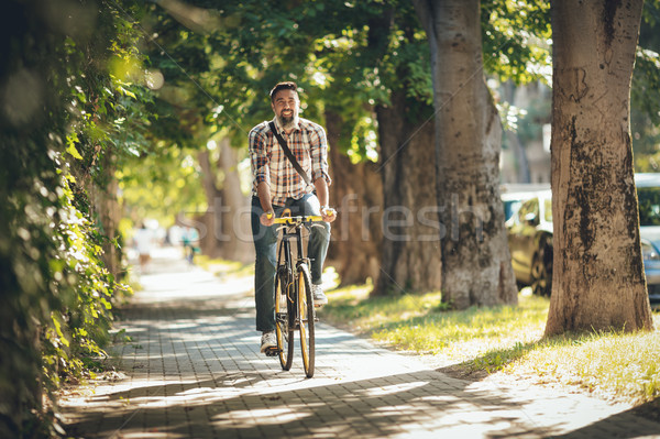 Stock photo: Handsome Man Riding Bicycle