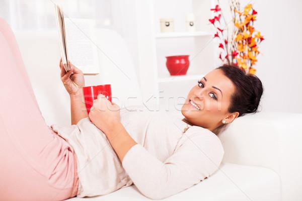 Szabadidős tevékenység gyönyörű fiatal nő pihen könyv otthon Stock fotó © MilanMarkovic78