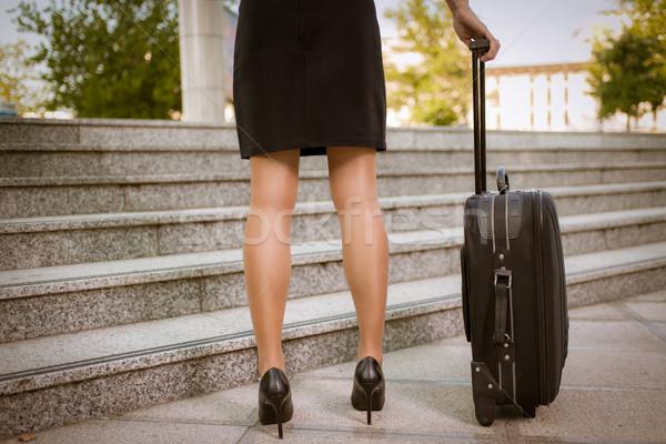 Iş gezisi kadın bacaklar bavul el Stok fotoğraf © MilanMarkovic78