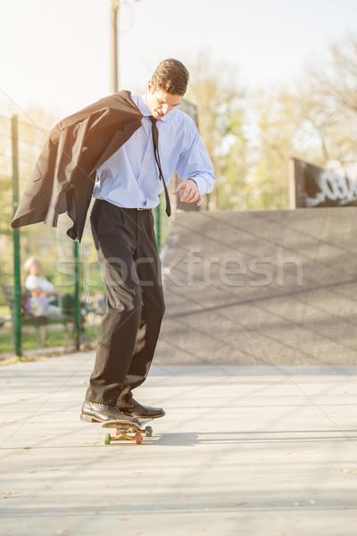 Businessman On Skateboard Stock photo © MilanMarkovic78