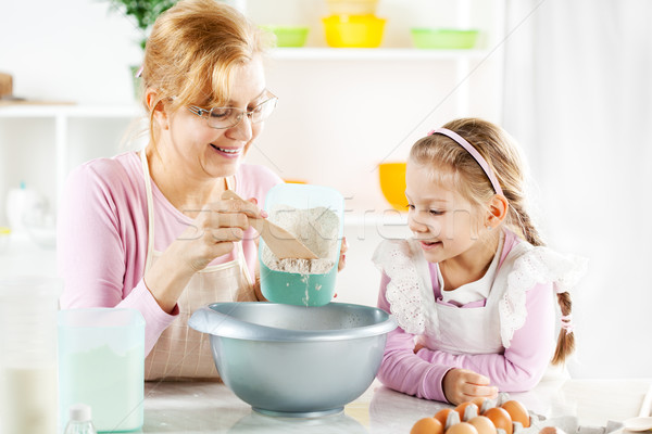 Grandmother and granddaughter making Dough Stock photo © MilanMarkovic78