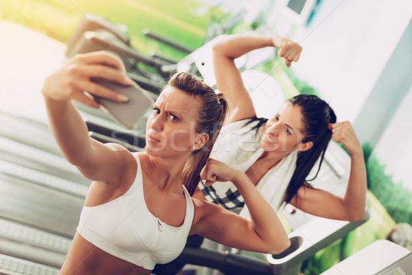 Two Girl Having Fun At The Gym Stock photo © MilanMarkovic78