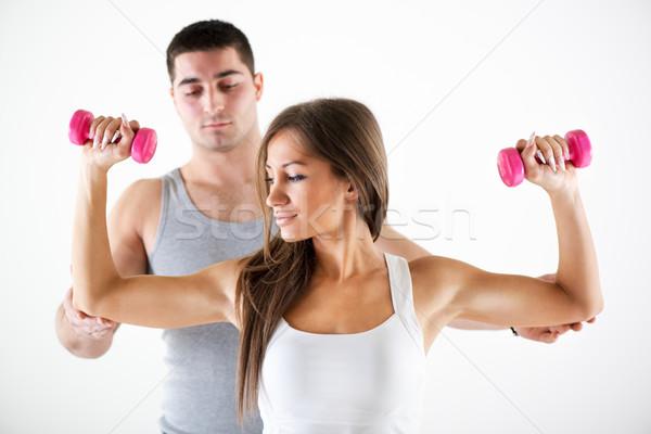 Personal trainer cliënt jonge mooie vrouw oefenen lichaam Stockfoto © MilanMarkovic78