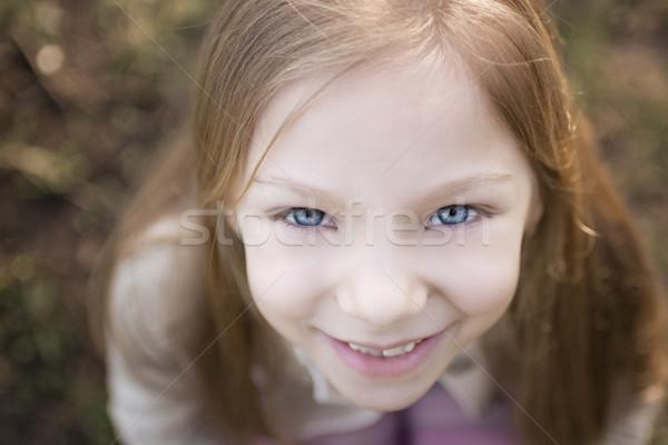 Kislány kék szemek közelkép lányok arc fölött Stock fotó © MilanMarkovic78