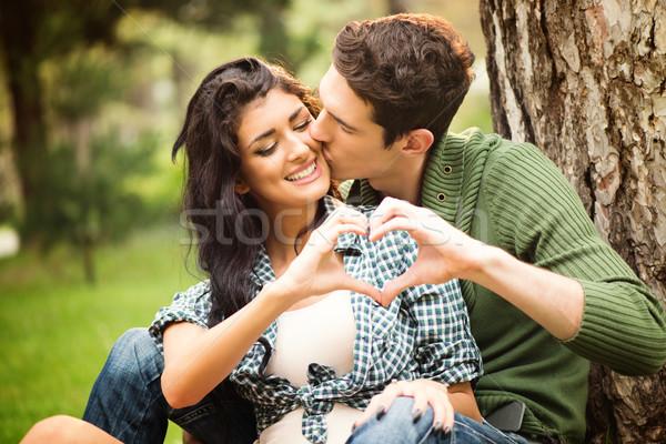 Szeretet levegő fiatal heteroszexuális pár ül fa Stock fotó © MilanMarkovic78
