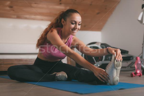Girl Doing Stretching Exercises  Stock photo © MilanMarkovic78