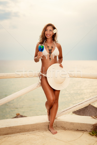 Girl With Cocktail On The Beach Stock photo © MilanMarkovic78