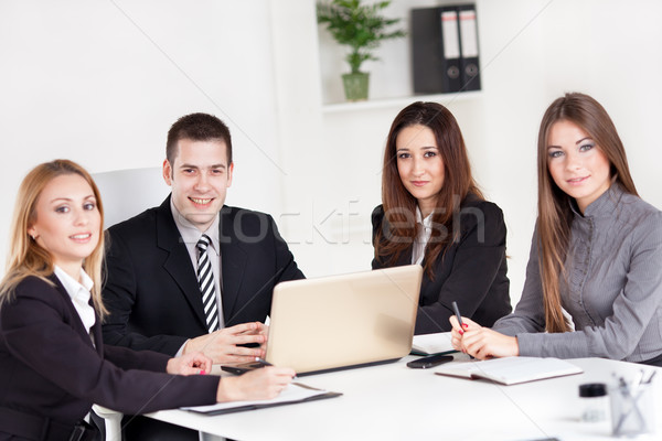 Zespół firmy cztery szczęśliwy ludzi biznesu biuro patrząc Zdjęcia stock © MilanMarkovic78