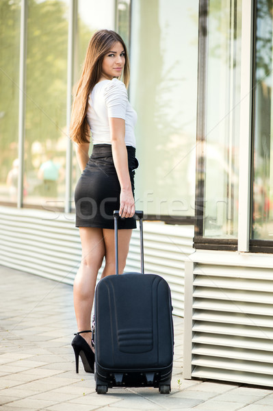 Businesswoman with suitcase Stock photo © MilanMarkovic78