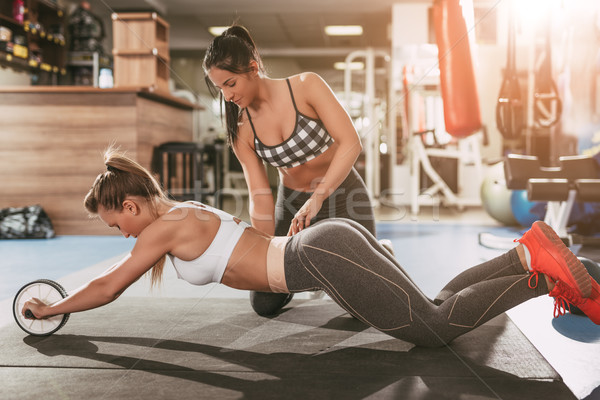 Girl Exercising With Instructor Stock photo © MilanMarkovic78