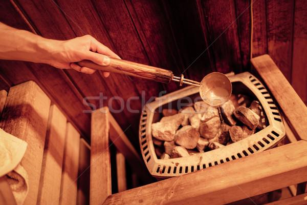 Sauna tanınmaz adam sıcak taşlar Stok fotoğraf © MilanMarkovic78