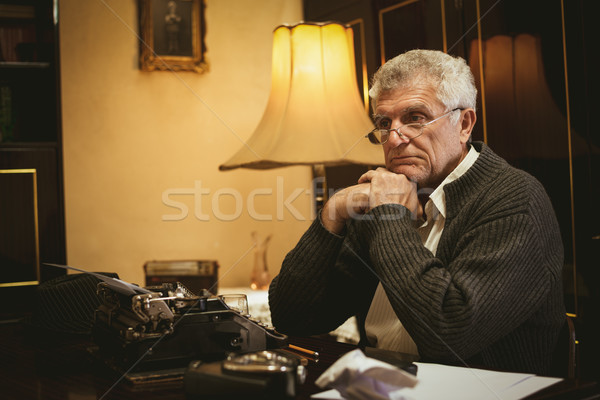 Pensive Retro Senior Man Writer Stock photo © MilanMarkovic78