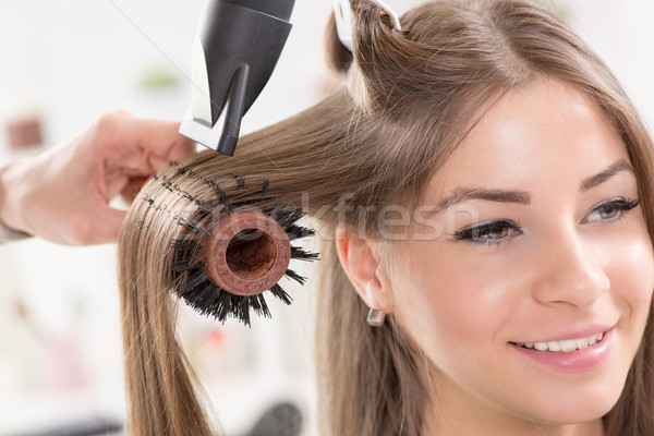 Peluquero largo secadora de pelo cepillo primer plano Foto stock © MilanMarkovic78