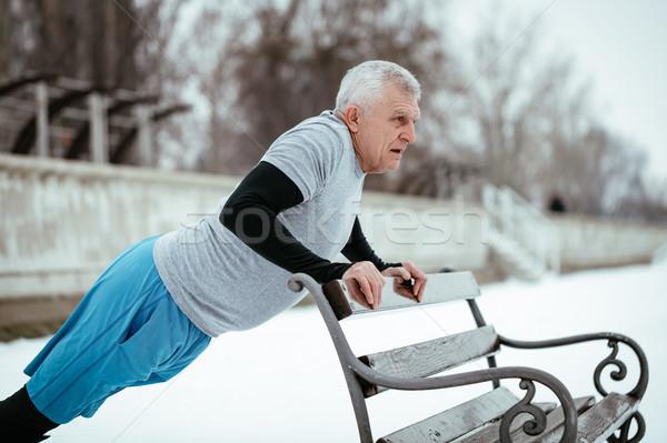 Senior Winter Push Ups Stock photo © MilanMarkovic78