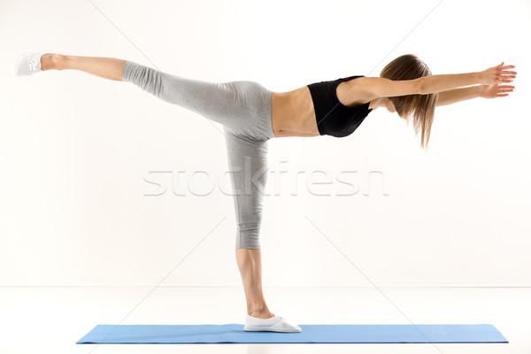Lány testmozgás jóga sportok ruházat áll Stock fotó © MilanMarkovic78