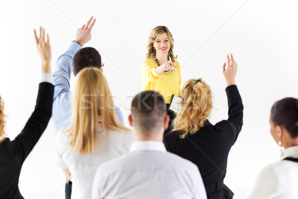 Businesswoman answering the questions Stock photo © MilanMarkovic78
