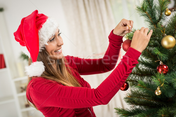 Girl Decorating Christmas Tree Stock photo © MilanMarkovic78