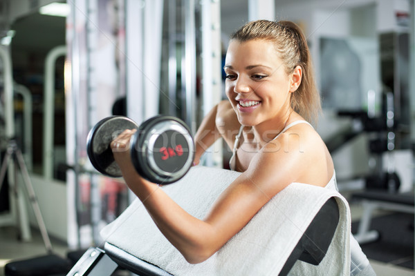 Young woman doing Biceps exercise Stock photo © MilanMarkovic78
