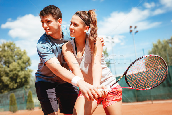 Girl Practice Tennis With Coach Stock photo © MilanMarkovic78