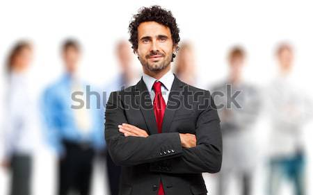 Smiling leader in front of a group of business people Stock photo © Minervastock