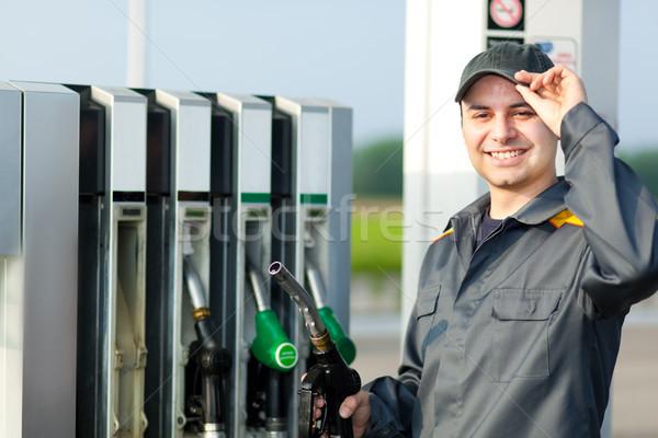Férfi tart üzemanyag fúvóka kéz munkás Stock fotó © Minervastock