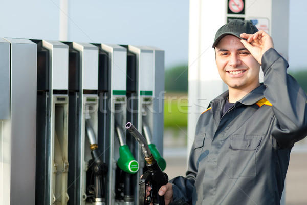 Man holding a fuel nozzle Stock photo © Minervastock