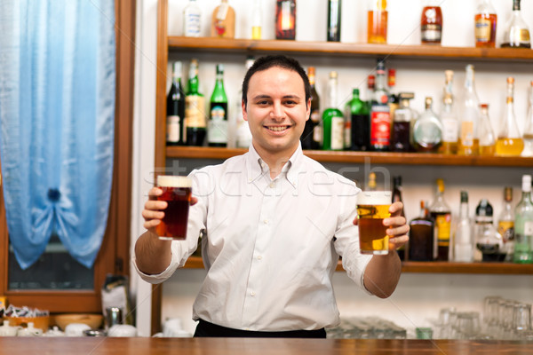 Bartender serving beers Stock photo © Minervastock