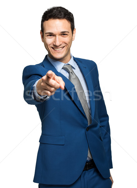 Portrait of young businessman pointing finger at viewer Stock photo © Minervastock