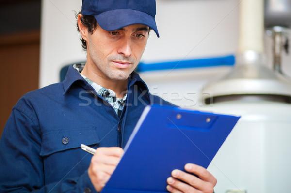 Technician servicing an hot-water heater Stock photo © Minervastock
