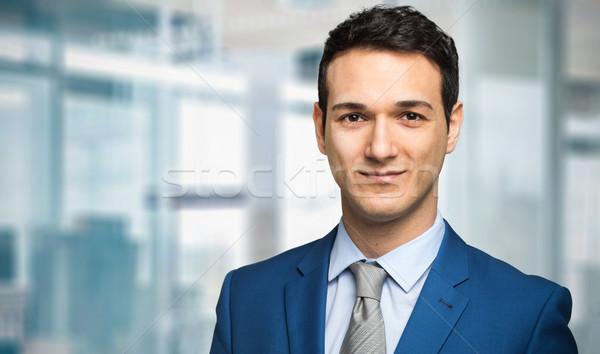 Sorridente empresário negócio escritório homem trabalhar Foto stock © Minervastock