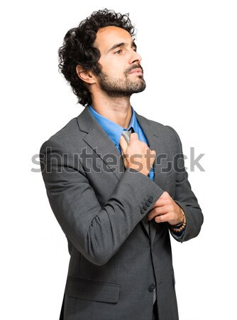 Handsome businessman adjusting his tie Stock photo © Minervastock
