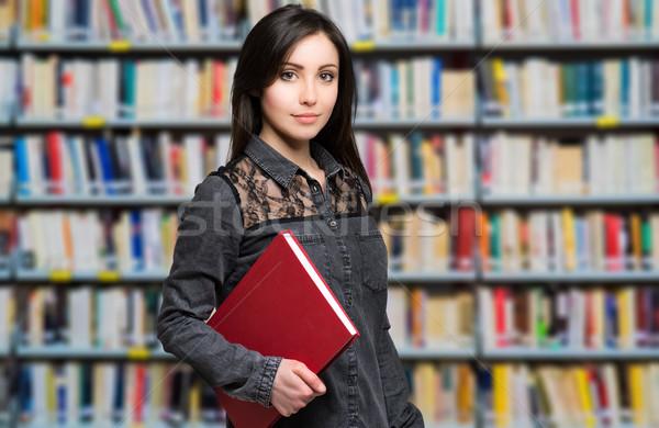 Fiatal lány áll könyvtár füzet kéz tart Stock fotó © Minervastock