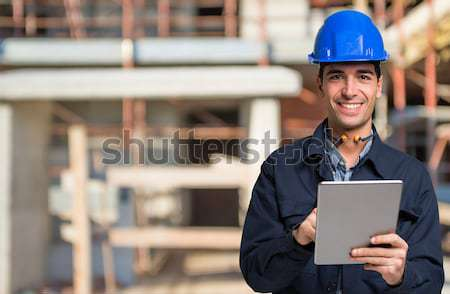 Construction specialist using a tablet computer Stock photo © Minervastock