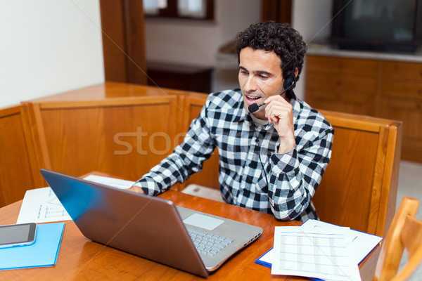 Cara fone computador portátil internet cara Foto stock © Minervastock