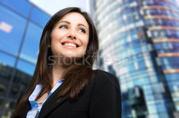 Beautiful businesswoman in a business district Stock photo © Minervastock