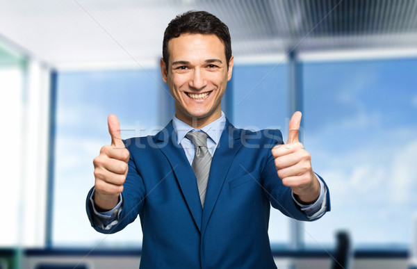 Businessman giving two thumbs up Stock photo © Minervastock