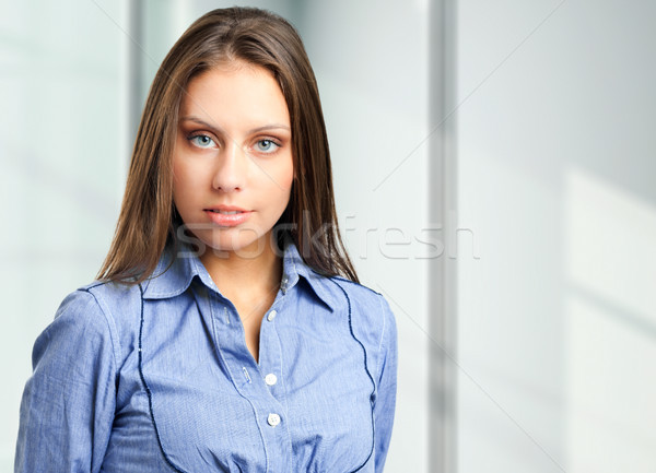 Friendly female manager portrait in her office Stock photo © Minervastock