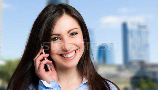 Iş kadını konuşma cep telefonu iş mutlu hareketli Stok fotoğraf © Minervastock