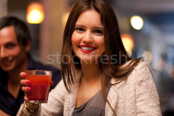 Kobieta pić publikacji piękna kobieta dziewczyna sexy Zdjęcia stock © Minervastock