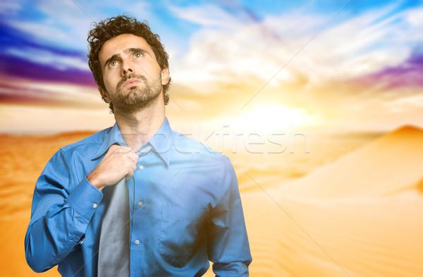 Fired businessman sweating in the desert Stock photo © Minervastock