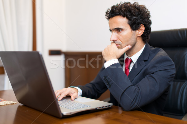 Businessman using a laptop in his office Stock photo © Minervastock