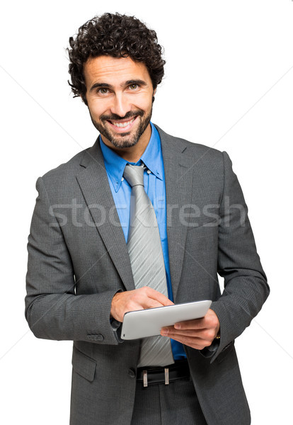Portrait of a businessman using a digital tablet. Isolated on white  Stock photo © Minervastock