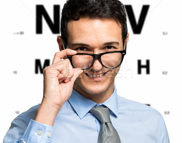 Man taking an eye exam and wearing glasses Stock photo © Minervastock