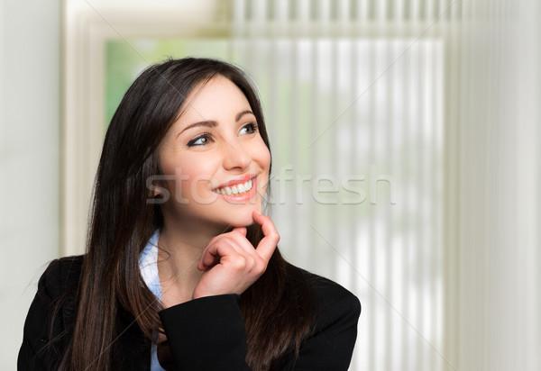 Gülen genç kadın kadın gülümseme mutlu çalışmak Stok fotoğraf © Minervastock